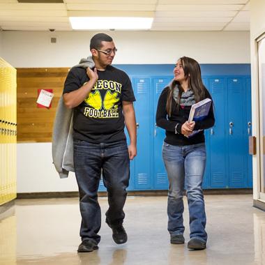 students walking down hallway